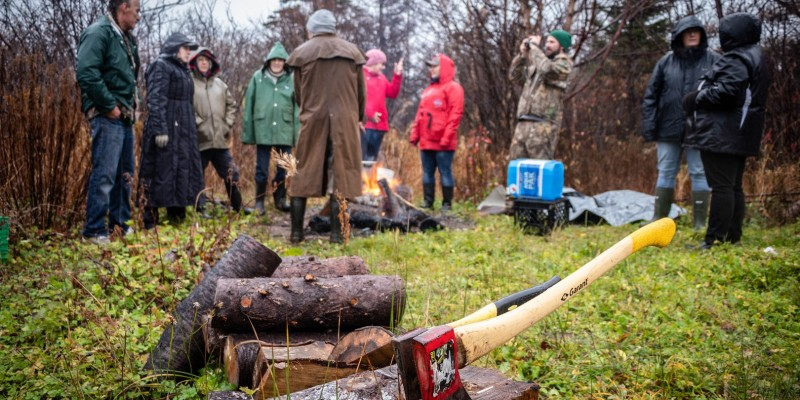 Participants make tea over the open fire following a medicine walk with Elder Terry Muise